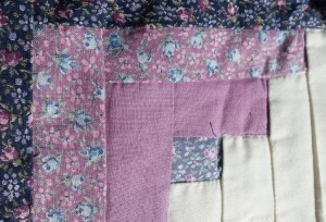 A square from my first quilt, tiny light blue, purple, and pink flowers mixed with a pink-purple. I loathe calicoes now.