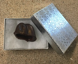 The chocolate ears tucked into a silver foil gift box for later